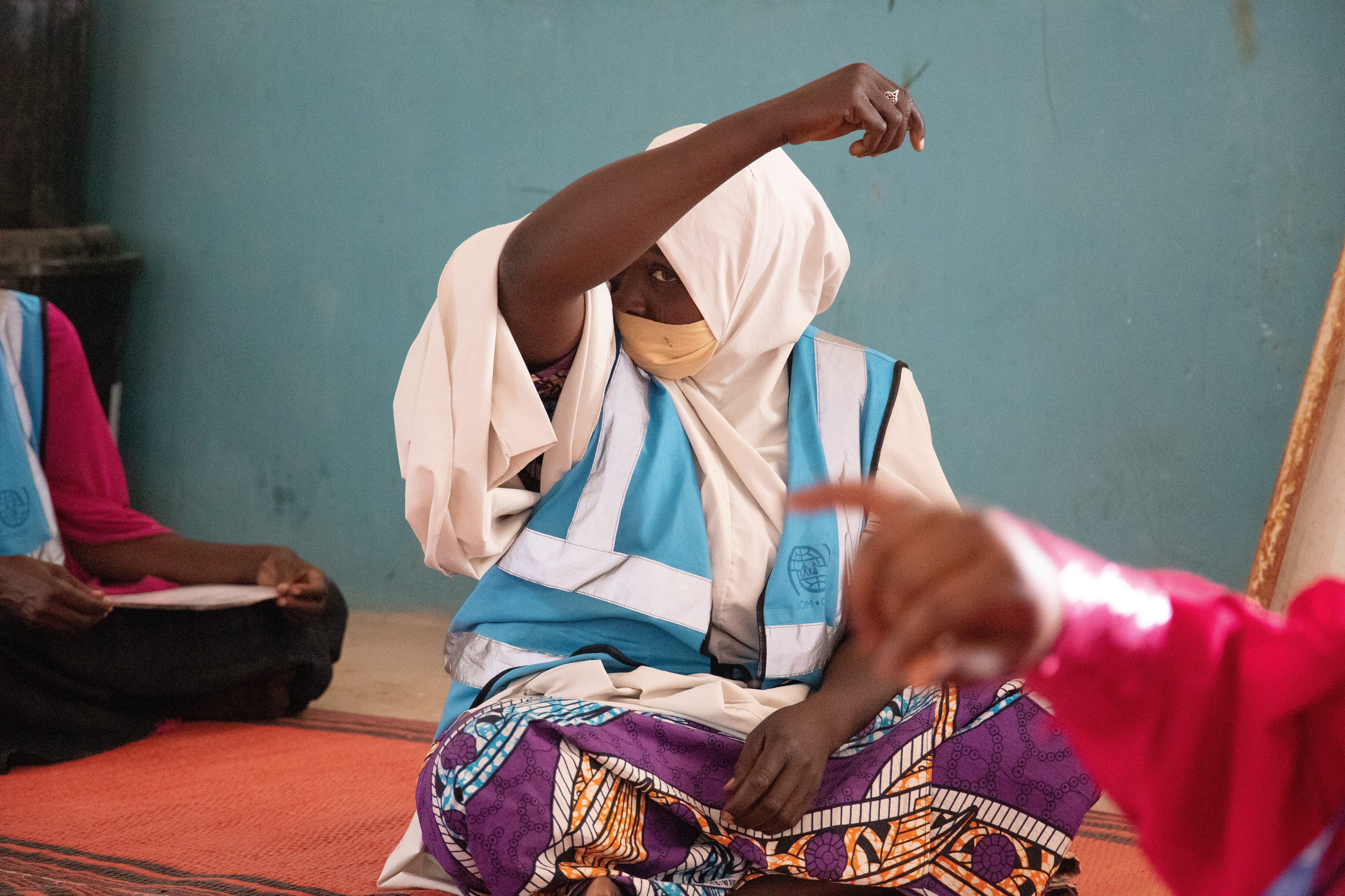 Hajara demonstrates proper coughing techniques during a training session for community volunteers at NYSC camp. Photo: Mshelia Yakubu 2021