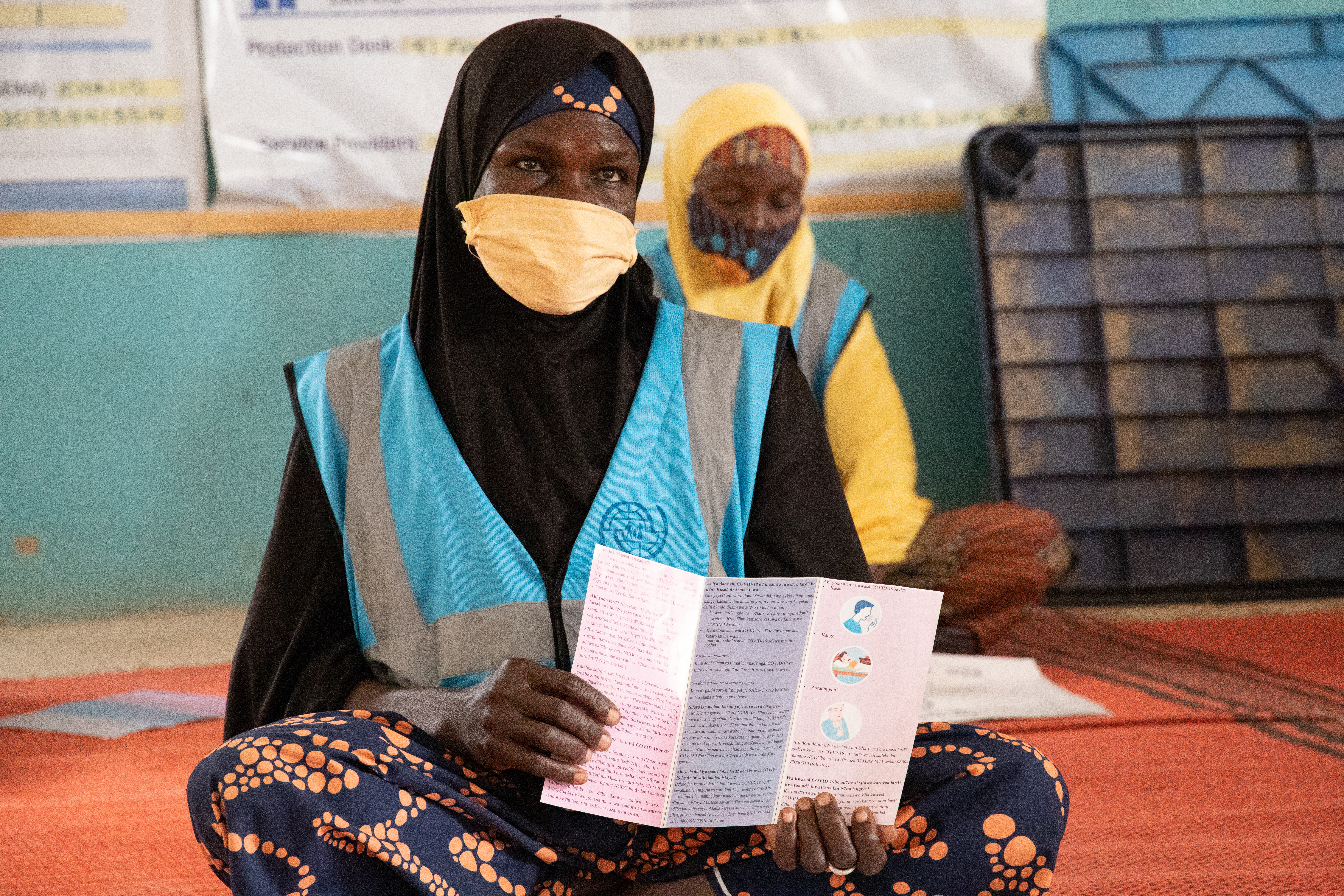 A group of IDP women discuss COVID-19 prevention measures at NYSC camp. Photo: Mshelia Yakubu/IOM 2021